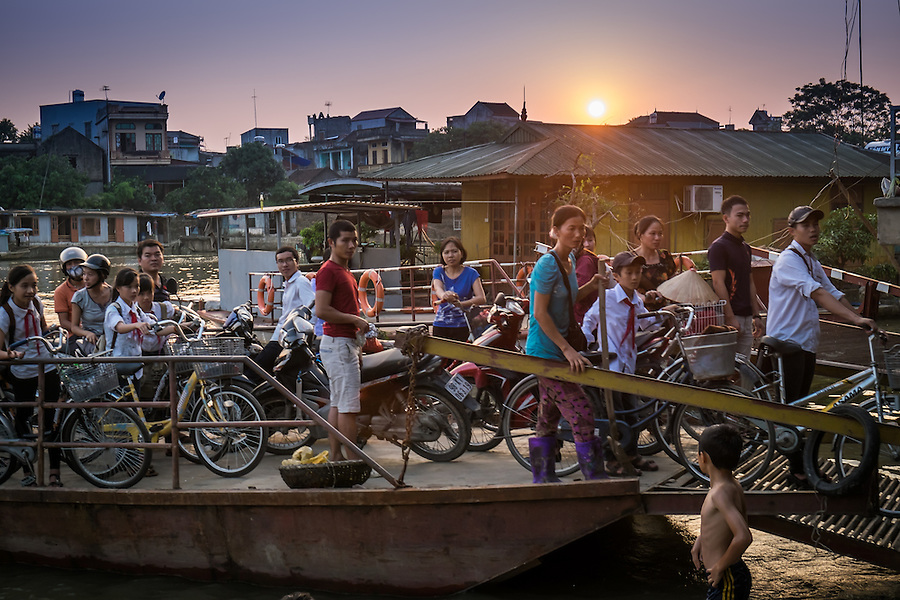 VAN HA, VIETNAM - CIRCA SEPTEMBER 2014: People coming to the Lang Gom Tho Ha via ferry, the village belongs to the Van Ha commune, it is located 50km away from Hanoi in Northern Vietman
