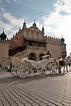 A horse carriage in front of the Cloth Hall in Krakow, Poland on the Main Market Square which is the largest medieval square in Europe and dates back to the 13th century