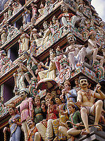 Writhing figures decorate the outside of a Hindu temple in Little India, Singapore. Singapore is a country in Malaysia. The population is mainly Chinese although Malays and Indians constitute large minorities. Buddhism, Islam, Hinduism, and Christian ity
