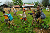 Happy Ethiopian children run alongside visitors as they leave the village-as a celebratory goodbye gesture.
