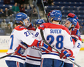 Zack Kamrass (UML - 27), Ryan McGrath (UML - 10), Jake Suter (UML - 28), Derek Arnold (UML - 29) - The University of Massachusetts Lowell River Hawks defeated the visiting American International College Yellow Jackets 6-1 on Tuesday, December 3, 2013, at Tsongas Arena in Lowell, Massachusetts.