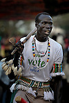 A member of the choir of the Christ the King Catholic parish in Malakal, Southern Sudan, sings and dances during Mass on November 21, 2010. His shirt encourages participation in a January 2011 referendum on the region's independence from the government in Khartoum.