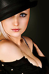girl in black hat looking at camera