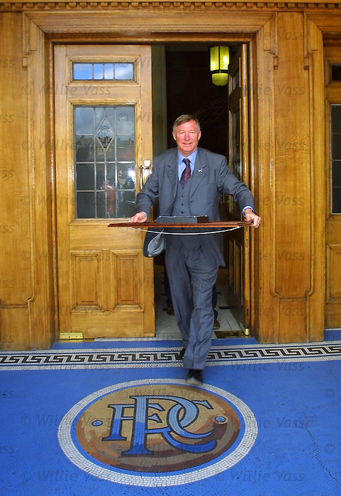Sir Alex Ferguson leaving the font door of Ibrox Stadium, 2001
