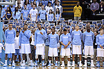 """05 January 2015: UNC students, behind the players, honor the late ESPN broadcaster and UNC alumnus Stuart Scott with """"STU"""" signs during a moment of silence. The University of North Carolina Tar Heels played the University of Notre Dame Fighting Irish in an NCAA Division I Men's basketball game at the Dean E. Smith Center in Chapel Hill, North Carolina."""