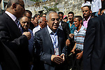 Palestinian Prime Minister Salam Fayyad casts his vote for the municipal elections at a polling station in the West Bank village of of Deir al-Ghusun north of Tulkarm, on October 20, 2012. Palestinians in the West Bank voted in local elections in what was the first time they had gone to the polls since 2006. Photo by Nedal Eshtayah