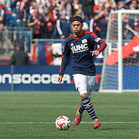 New England Revolution midfielder Lee Nguyen (24) looks to pass. In a Major League Soccer (MLS) match, the New England Revolution (blue/white) tied Vancouver Whitecaps FC (white), 0-0, at Gillette Stadium on March 22, 2014.