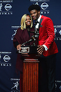 New York, NY - December 10, 2016: After winning the 2016 Heisman Trophy, Louisville quarterback Lamar Jackson poses with his mother, Felicia James, during a news conference at the New York Marriott Marquis, December 10, 2016. At the time Jackson won the Heisman, he has a total of 4,928 offensive yards, 2nd of all-time for a Heisman winner. (Photo by Don Baxter/Media Images International)
