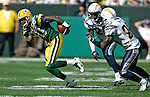 Green Bay Packers' Donald Driver is chased down by San Diego Chargers' Drayton Florence and Marlon McCree for a 24-yard reception in the 4th quarter. .The Green Bay Packers hosted the San Diego Chargers at Lambeau Field in Green Bay Sunday September 23, 2007. Steve Apps-State Journal.