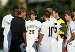 2 September 2007: Wake Forest head coach Jay Vidovich (in black) talks to his players including Justin Lichtfuss (26) and Corben Bone (10). The Wake Forest University Demon Deacons defeated the Monmouth University Hawks 2-0 at Fetzer Field in Chapel Hill, North Carolina in an NCAA Division I Men's Soccer game.