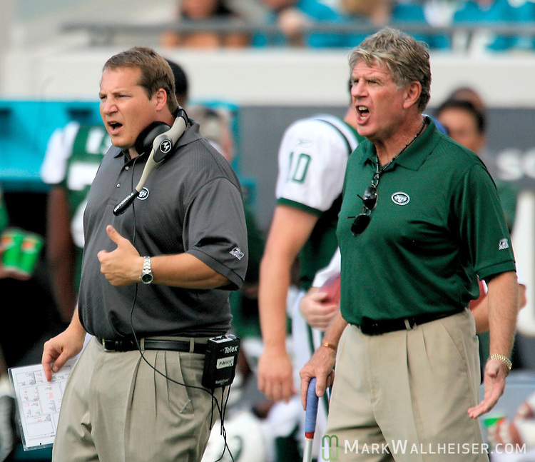 New York Jets head coach eric Mangini (L) and Sam Gash (R) coach of the runningbacks and special teams protest a call in their NFL game against the Jacksonville Jaguars at Alltel Stadium in Jacksonville, Florida October 8, 2006.