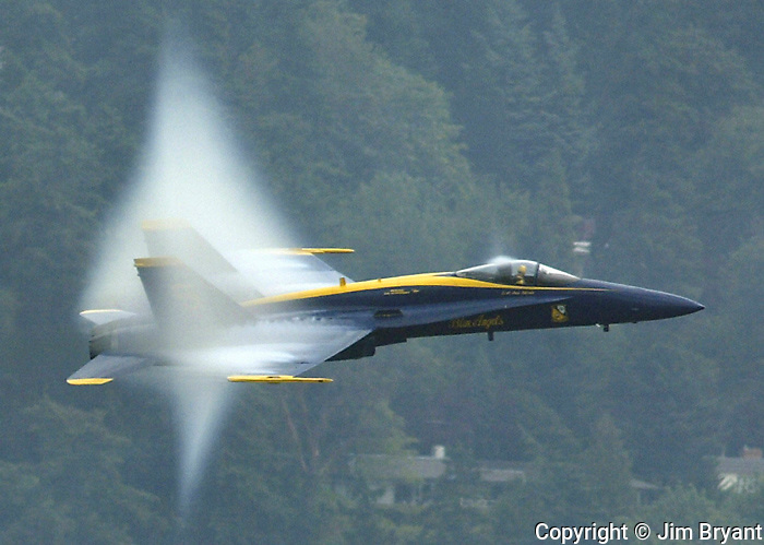 """Lt. Cmdr. Dan """"Dino"""" Martin, Lead Solo of the U.S. Navy Flight Demostration Team, flies his F-18 fighter through a a vapor bubble his jet created on Saturday, August 2, 2003 at the 53rd General Motors Cup on Lake Washington in Seattle . Jim Bryant Photo"""