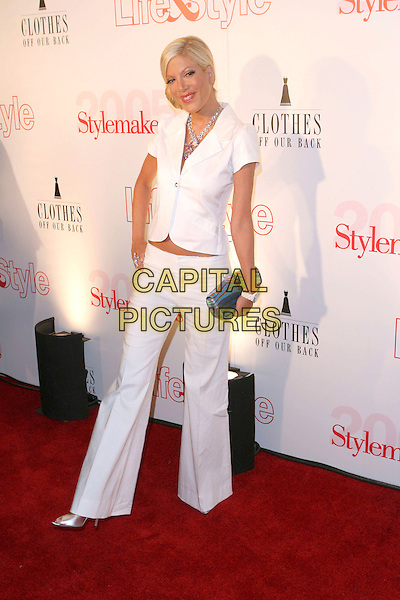 TORI SPELLING.Attends Life & Style Magazine Presents Stylemakers 2005 held at the Monmartre Lounge, Hollywood, California. USA, 26 May 2005. .Full length white short sleeved jacket S necklace diamante trousers clutch bag.Ref: ADM.www.capitalpictures.com.sales@capitalpictures.com.©Zach Lipp /AdMedia/Capital Pictures.