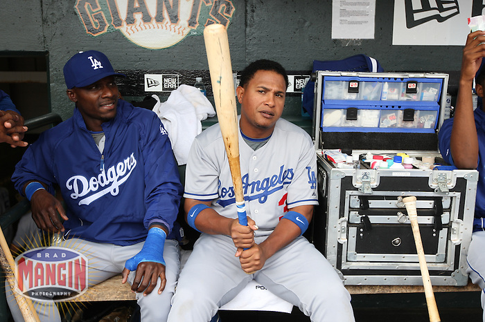 SAN FRANCISCO - SEPTEMBER 13:  Orlando Hudson and Ronnie Belliard of the Los Angeles Dodgers get ready in the dugout before the game against the San Francisco Giants at AT&T Park on September 13, 2009 in San Francisco, California. Photo by Brad Mangin