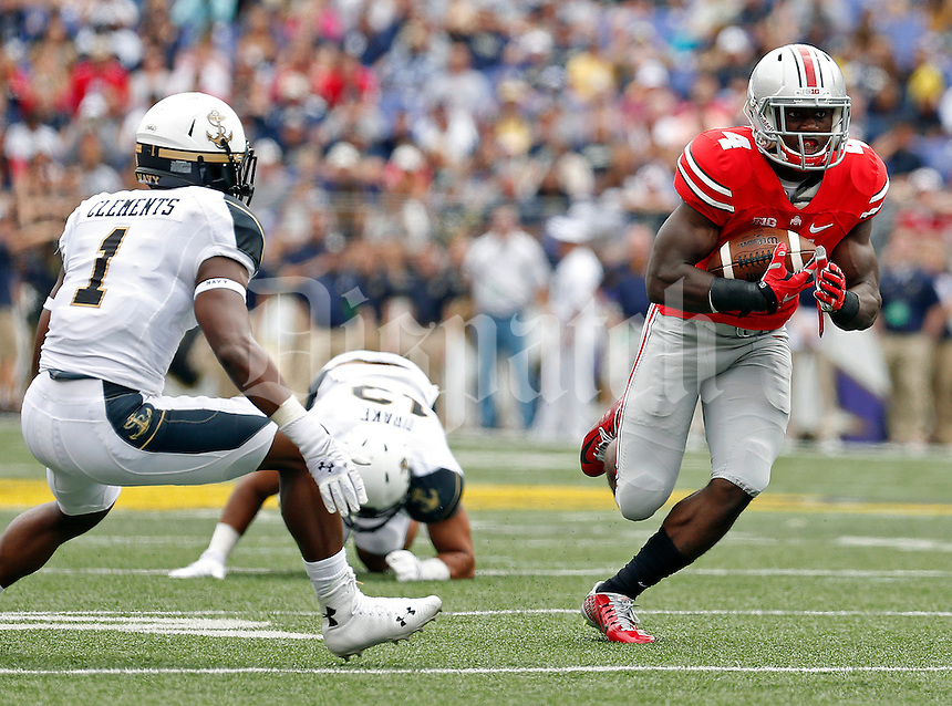 Ohio State Buckeyes running back Curtis Samuel (4) carries the ball against Navy Midshipmen cornerback Brendon Clements (1) in the 2nd quarter of their NCAA game at M&T Bank Stadium in Baltimore, Maryland on August 30, 2014. (Dispatch photo by Kyle Robertson)