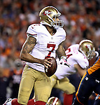 SHOT 10/19/14 6:15:51 PM - San Francisco 49ers quarterback Colin Kaepernick #7 looks to pass against the Denver Broncos at Sports Authority Field at Mile High Sunday October 19, 2014 in Denver, Co. The Broncos beat the 49ers 42-17.<br /> (Photo by Marc Piscotty / &copy; 2014)