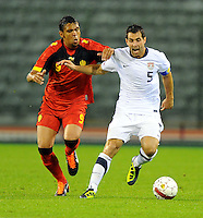 Carlos Bocanegra (r) of team USA and Igor De Camargo of team Belgium during the friendly match Belgium against USA at King Baudoin stadium in Brussel, Belgium on September 06th, 2011.