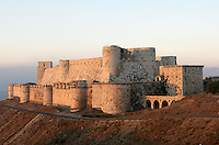 Krak des Chevaliers, Qala'at al-Husn, originally built 1031 for amir of Aleppo, occupied by Crusader Tancred of Galilee in 1110, and given in 1144 to Knights Hospitaller, who rebuilt it as the largest Crusader castle in the Levant. Finally recaptured in 1271 and further modified by Mamluk Sultan Baybars, Homs Gap, Syria Picture by Manuel Cohen