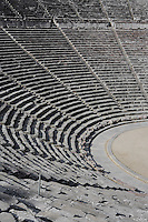 EPIDAURUS, GREECE - APRIL 15 : A detail of the Cavea and paved drainage depression of the Theatre, on April 15, 2007 in Epidaurus, Greece. The Theatre, designed by Polykleitos the Younger, was built in the late 4th century BC and extended in the Hellenistic period. It was rediscovered in 1881 and significantly restored in the 1950s.  It has the three main features of a Greek theatre: the orchestra, the skene and the cavea, a raked semi-circular auditorium with radiating diazomas. The theatre is renowned for its accoustics thanks to the symmetry of the cavea, seen here in the morning light. (Photo by Manuel Cohen)