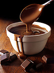 Melted Choclate being stirred in a bowl - Stock Photos.