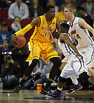 Northern Iowa's Wes Washpun (11) and Nate Buss guards Wyoming's Alan Herndon (32) 2015 NCAA Division I Men's Basketball Championship March 20, 2015 at the Key Arena in Seattle, Washington.   Northern Iowa beat Wyoming 71 to 54.   ©2015.  Jim Bryant Photo. All Rights Reserved.