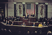 United States President Jimmy Carter presents his National Energy Plan to a joint session of the US Congress in the US Capitol in Washington, DC on April 20, 1977. Seated behind the President are US Vice President Walter Mondale, left, and the Speaker of the US House of Representatives Tip O'Neill (Democrat of Massachusetts).<br /> Credit: Arnie Sachs / CNP