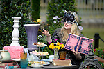 A Tea party Celebrating 150 years since Lewis Carroll's  Alice's adventures in Wonderland was first published<br /> at the RHS Hampton Court Flower show. <br /> <br /> Bethany Clarke / RHS / London 29.6.15