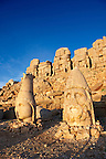 Image of the statues of around the tomb of Commagene King Antochus 1 on the top of Mount Nemrut, Turkey. Stock photos &amp; Photo art prints. In 62 BC, King Antiochus I Theos of Commagene built on the mountain top a tomb-sanctuary flanked by huge statues (8&ndash;9 m/26&ndash;30 ft high) of himself, two lions, two eagles and various Greek, Armenian, and Iranian gods. The photos show the broken statues on the  2,134&nbsp;m (7,001&nbsp;ft)  mountain. 4