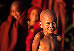 Young novice monks following a late afternoon bath at the monastery well in Mindat, Myanmar (Burma).