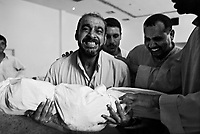 Moussayib, Iraq, May 24, 2003.A man has just found his brother among more than 400 bodies from people missing since their arrest by Hussein Kamal, Saddam's son-in-law and his men, in March 1991. They were found in mass-graves in Djur Al Saher and have been brought to a theater hall in Moussayib to allow identification by the families. .