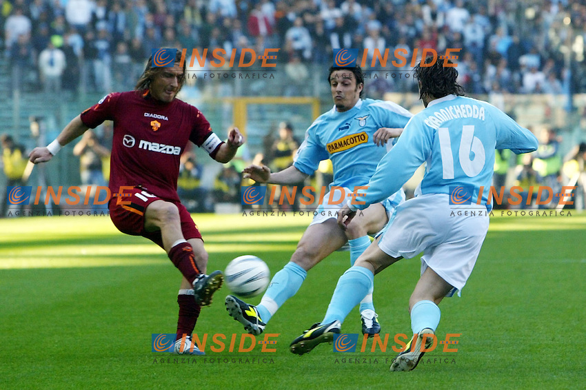 Roma 21/4/2004 Campionato Italiano Serie A <br /> Lazio - Roma 1-1 <br /> Francesco Totti (Roma) Massimo Oddo (Lazio) e giuliano giannichedda (Lazio)<br /> Lazio and Roma are playing again after it was suspended on March 21, 2004, for security reasons.  <br /> Foto Andrea Staccioli Insidefoto