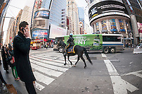 An mounted NYPD officer in New York patrols Times Square on Tuesday, March 22, 2016. Security in New York has been heightened in the wake of the terrorist bombings in Brussels, Belgium. (© Richard B. Levine)