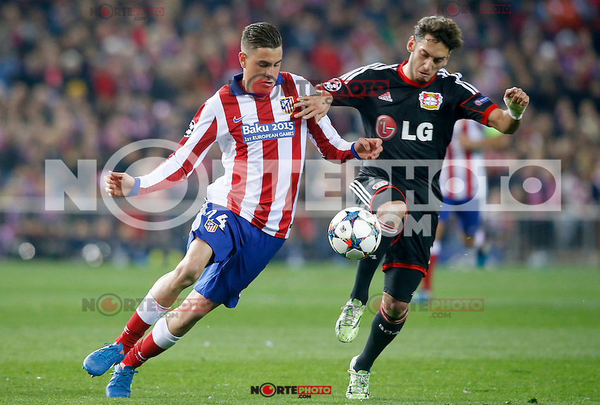 Atletico de Madrid's Jose Maria Gimenez (l) and Bayer 04 Leverkusen's Arda Turan during Champions League 2014/2015 match.March 16,2015. (ALTERPHOTOS/Acero) /NORTEphoto.com