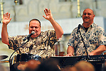 TORRINGTON, CT- 04 JANUARY 2008 --010409JS01-John Banker, left, of the band Island Rhythm, gets the crowd in a festive mood as fellow member Al LaPorte, right, plays the keyboards during their show at the annual Three Kings Day celebration Sunday at the Trinity Episcopal Church in Torrington. <br /> Jim Shannon / Republican-American