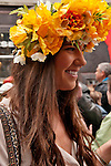A woman wears a ring of yellow flowers to the Easter Parade in New York City on Fifth Avenue