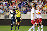 Referee Terry Vaughn issues a red card to Jan Gunnar Solli (8) of the New York Red Bulls during a Major League Soccer (MLS) match against the Vancouver Whitecaps at Red Bull Arena in Harrison, NJ, on September 10, 2011.