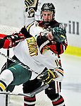 26 November 2010: University of Vermont Catamount forward H.T. Lenz (11), a Freshman from Vienna, VA, is grabbed by Northeastern University Huskies' forward Tyler McNeely, a Senior from Burnaby, British Columbia at Gutterson Fieldhouse in Burlington, Vermont. The Huskies came back from a 2-0 deficit to earn a 2-2 tie against the Catamounts. Mandatory Credit: Ed Wolfstein Photo