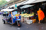 Thewet Market, Bangkok, Thailand. Monks collecting alms in the early morning