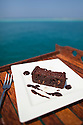 Chocolate brownie with nuts and cream sauce.  Ocean Dancer, Maldives