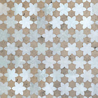 Cadiz, a natural stone waterjet mosaic shown in Ming Green polished and Jura Grey honed, is part of the Miraflores Collection by Paul Schatz for New Ravenna Mosaics.<br />