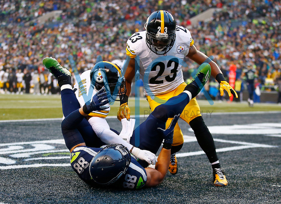 Mike Mitchell #23 and Antwon Blake #41 of the Pittsburgh Steelers defend a pass in the end zone to Jimmy Graham #88 of the Seattle Seahawks in the second half during the game at CenturyLink Field on November 29, 2015 in Seattle, Washington. (Photo by Jared Wickerham/DKPittsburghSports)