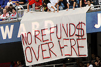"""New York Red Bulls fans hang a banner reading """"No refund$ over here"""" at the start of the game. The Seattle Sounders defeated the New York Red Bulls 1-0 during a Major League Soccer (MLS) match at Red Bull Arena in Harrison, NJ, on May 15, 2010."""