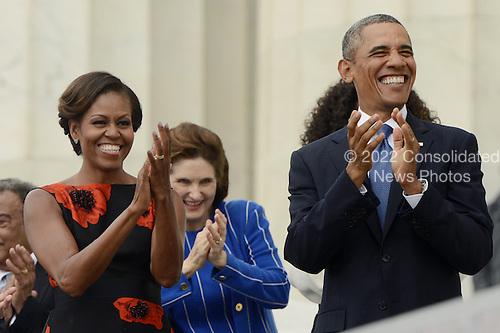 US President Barack Obama (front R) and First Lady Michelle Obama (front L) attend the 'Let Freedom Ring' commemoration event at the Lincoln Memorial in Washington DC, USA, 28 August 2013. The event was held to commemorate the 50th anniversary of the 28 August 1963 March on Washington led by the late Dr. Martin Luther King Jr., where he famously gave his 'I Have a Dream' speech.<br /> Credit: Michael Reynolds / Pool via CNP
