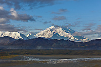 The north and south summits of Denali are visible with the McKinley river in the foreground, Denali National park, Alaska.