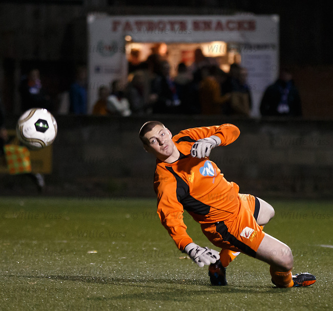 Chris Smith watches the ball crash back down from the bar and away to safety