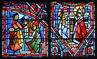 Fulbert as artistic advisor (left) working with a master sculptor on the new cathedral after the fire of 1020 and Fulbert's piety to the Virgin Mary (right) with Fulbert worshipping the Virgin and child, from the Life of Fulbert stained glass window, in the south transept of Chartres Cathedral, Eure-et-Loir, France. This window replaces the original 13th century window depicting the Life of St Blaise, which was destroyed in 1791. It was created in 1954 by Francois Lorin as a gift of the Institute of American Architects, on a theme chosen by the Canon Yves Delaporte. It depicts the life of Fulbert, bishop of Chartres in the 11th century. Chartres cathedral was built 1194-1250 and is a fine example of Gothic architecture. Most of its windows date from 1205-40 although a few earlier 12th century examples are also intact. It was declared a UNESCO World Heritage Site in 1979. Picture by Manuel Cohen
