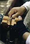 A craftsman uses a variety of knives and chisels to give the toy wooden horse a more detailed appearance at the Hachinohe Toy Wooden Horse Factory in Hachinohe, Japan. The Hachinohe horse or Yawata Uma is made in a small factory, where, for eight hours a day, six days a week, 11 workers cuts, chisel, sand, paint and shellac wooded horses of all sizes ranging from just over an inch to nearly a foot high. (Jim Bryant Photo)........
