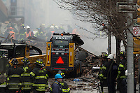 NYC firefighters search for people on debris after than a powerful explosion knocked two residential buildings in East Harlem killing 2 people and injuring at least 22 others in New York. March 12, 2014. Photo by Eduardo Munoz Alvarez/VIEW
