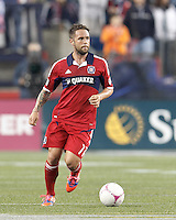 Chicago Fire midfielder Daniel Paladini (11) looks to pass. In a Major League Soccer (MLS) match, the New England Revolution (blue) defeated Chicago Fire (red), 1-0, at Gillette Stadium on October 20, 2012.