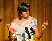 Washington, D.C. - May 12, 2009 -- First Lady Michelle Obama  makes remarks as she and United States President Barack Obama host &quot;An Evening of Poetry, Music and the Spoken Word in the East Room of the White House in Washington, DC on Tuesday, May 12, 2009..Credit: Ron Sachs / Pool via CNP